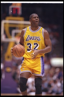 2 Feb 1996:  Guard Earvin (Magic) Johnson of the Los Angeles Lakers moves the ball during a game against the Chicago Bulls at the Great Western Forum in Inglewood, California.  The Bulls won the game, 99-84. Mandatory Credit: ALLSPORT USA  /Allsport Manda