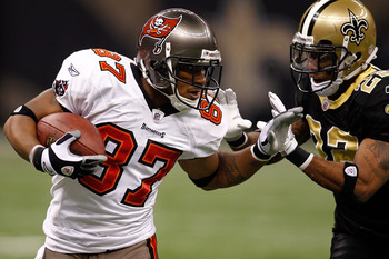 NEW ORLEANS, LA - JANUARY 02:  Preston Parker #87 of the Tampa Bay Buccaneers is pushed out of bounds by Tracy Porter #22 of the New Orleans Saints at the Louisiana Superdome on January 2, 2011 in New Orleans, Louisiana.  (Photo by Chris Graythen/Getty Im