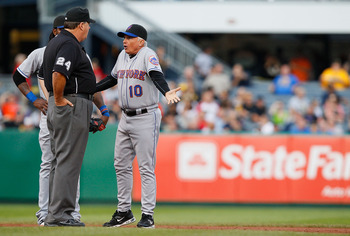 PITTSBURGH - JUNE 13: Manager Terry Collins #10 and Jose Reyes #7 of the New York Mets argues a call with second base umpire Jerry Layne during the game on June 13, 2011 at PNC Park in Pittsburgh, Pennsylvania.  (Photo by Jared Wickerham/Getty Images)