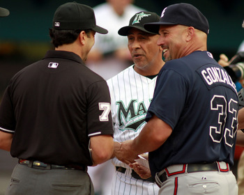 MIAMI GARDENS, FL - JUNE 07:  Manager Edwin Rodriguez of the Florida Marlins and former Marlins Manager Freddie Gonzalez #33 of the Atlanta Braves chats with the umpire prior to their game at Sun Life Stadium on June 7, 2011 in Miami Gardens, Florida.  Th