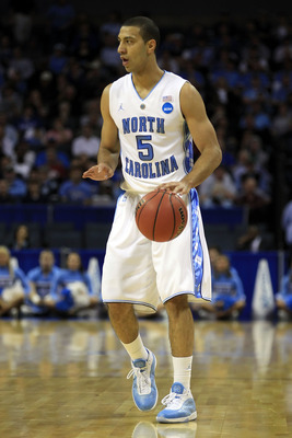 CHARLOTTE, NC - MARCH 20:  Kendall Marshall #5 of the North Carolina Tar Heels moves the ball while taking on the Washington Huskies during the third round of the 2011 NCAA men's basketball tournament at Time Warner Cable Arena on March 20, 2011 in Charlo