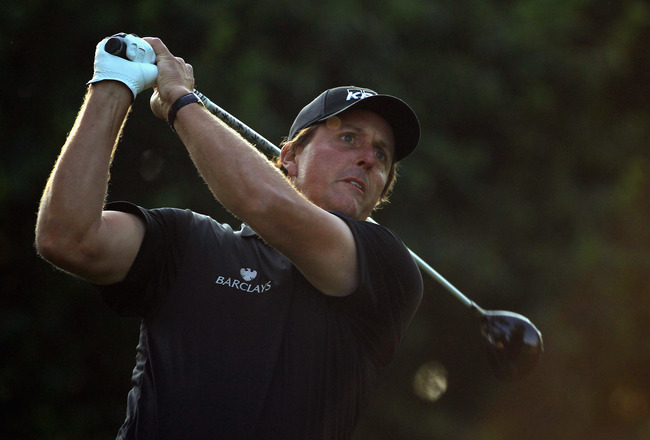 CHARLOTTE, NC - MAY 06:  Phil Mickelson watches his tee shot on the 11th hole during the second round of the Wells Fargo Championship at Quail Hollow Club on May 6, 2011 in Charlotte, North Carolina.  (Photo by Streeter Lecka/Getty Images)