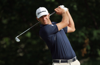 DUBLIN, OH - JUNE 03:  Dustin Johnson hits his tee shot on the 14th hole during the second round of the Memorial Tournament presented by Nationwide Insurance at the Muirfield Village Golf Club on June 3, 2011 in Dublin, Ohio.  (Photo by Scott Halleran/Get