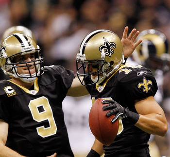 NEW ORLEANS, LA - DECEMBER 12:  Drew Brees #9 and Lance Moore #16 of the New Orleans Saints celebrate after scoring a touchdown against the St. Louis Rams at the Louisiana Superdome on December 12, 2010 in New Orleans, Louisiana. The Saints defeated the R