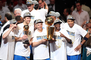 MIAMI, FL - JUNE 12:  (L-R) Brian Cardinal #35, Finals MVP Dirk Nowitzki #41, Jason Kidd #2, Jason Terry #31 and Shawn Marion #0 of the Dallas Mavericks celebrate with the Larry O'Brien trophy after they won 105-95 against the Miami Heat in Game Six of th