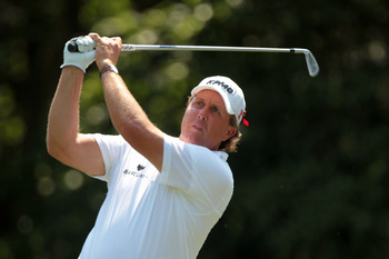 PONTE VEDRA BEACH, FL - MAY 12:  Phil Mickelson hits his tee shot on the eighth hole during the first round of THE PLAYERS Championship held at THE PLAYERS Stadium course at TPC Sawgrass on May 12, 2011 in Ponte Vedra Beach, Florida.  (Photo by Scott Hall