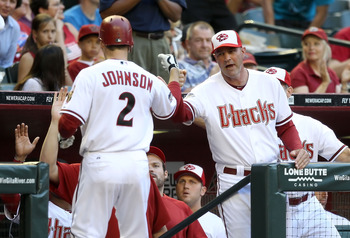 PHOENIX, AZ - MAY 30:  Manager Kirk Gibson of the Arizona Diamondbacks high fives Kelly Johnson #2 after Johnson hit a solo home run against the Florida Marlins during the third inning of the Major League Baseball game at Chase Field on May 30, 2011 in Ph