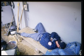 10 May 1997:  Groundskeeper takes a nap during game between the New York Yankees and the Kansas City Royals at Yankee Stadium in the Bronx, New York.  The Yankees won the game 3-2. Mandatory Credit: Al Bello  /Allsport