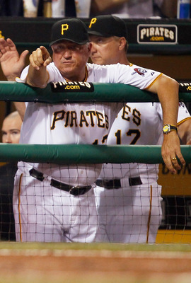 PITTSBURGH - JUNE 08:  Manager Clint Hurdle #13 of the Pittsburgh Pirates points to his players in the tenth inning against the Arizona Diamondbacks during the game on June 8, 2011 at PNC Park in Pittsburgh, Pennsylvania.  (Photo by Jared Wickerham/Getty