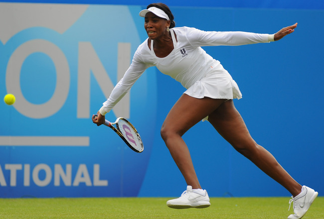 EASTBOURNE, ENGLAND - JUNE 13:  Venus Williams of USA plays a forehand in her match against Andrea Petkovic of Germany during Day Three of the AEGON International at Devonshire Park on June 13, 2011 in Eastbourne, England.  (Photo by Mike Hewitt/Getty Ima