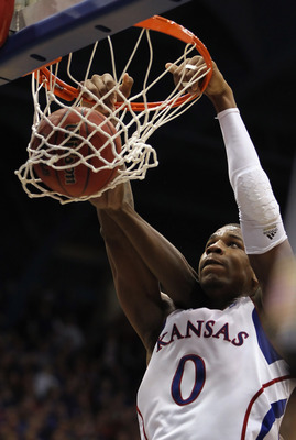 LAWRENCE, KS - JANUARY 29:  Thomas Robinson #0 of the Kansas Jayhawks dunks during the game against the Kansas State Wildcats on January 29, 2011 at Allen Fieldhouse in Lawrence, Kansas.  (Photo by Jamie Squire/Getty Images)