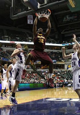INDIANAPOLIS, IN - MARCH 10:  Trevor Mbakwe #32 of the Minnesota Golden Gophers dunks against the Northwestern Wildcats during the first round of the 2011 Big Ten Men's Basketball Tournament at Conseco Fieldhouse on March 10, 2011 in Indianapolis, Indiana