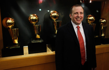 DEERFIELD, IL - JUNE 23: Tom Thibodeau, the new head coach of the Chicago Bulls, poses in front of the Bulls Championship trophies following a press conference at the Berto Center practice facility on June 23, 2010 in Deerfield, Illinois. NOTE TO USER: Us