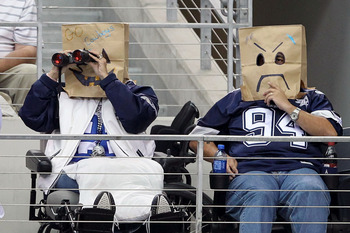 ARLINGTON, TX - OCTOBER 31:  Fans of the Dallas Cowboys wear brown paper bags over their head as they watch the Cowboys play against the Jacksonville Jaguars at Cowboys Stadium on October 31, 2010 in Arlington, Texas.  (Photo by Chris Chambers/Getty Image