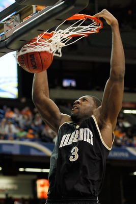 ATLANTA, GA - MARCH 12:  Festus Ezeli #3 of the Vanderbilt Commodores dunks on the Florida Gators during the semifinals of the SEC Men's Basketball Tournament at Georgia Dome on March 12, 2011 in Atlanta, Georgia.  (Photo by Kevin C. Cox/Getty Images)