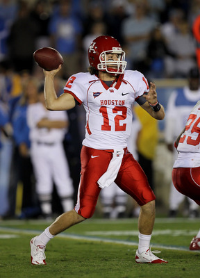 PASADENA, CA - SEPTEMBER 18:  Quarterback Cotton Turner #12 of the Houston Cougars throws a pass against the UCLA Bruins at the Rose Bowl on September 18, 2010 in Pasadena, California.  UCLA won 31-13.  (Photo by Stephen Dunn/Getty Images)