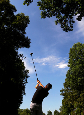BETHESDA, MD - JUNE 13:  Graeme McDowell of Northern Ireland plays a shot during a practice round prior to the start of the 111th U.S. Open at Congressional Country Club on June 13, 2011 in Bethesda, Maryland.  (Photo by Ross Kinnaird/Getty Images)