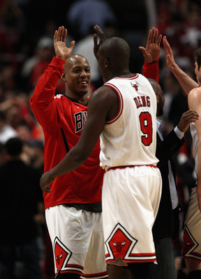 CHICAGO, IL - APRIL 26: Keith Bogans #6 of the Chicago Bulls congratulates teammate Loul Deng #9 during a brake against the Indiana Pacers in Game Five of the Eastern Conference Quarterfinals in the 2011 NBA Playoffs at the United Center on April 26, 2011