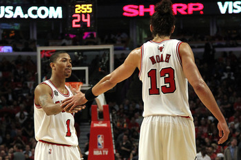 CHICAGO, IL - MAY 26: Derrick Rose #1 and Joakim Noah #13 of the Chicago Bulls celebrate a play against the Miami Heat in Game Five of the Eastern Conference Finals during the 2011 NBA Playoffs on May 26, 2011 at the United Center in Chicago, Illinois. NO