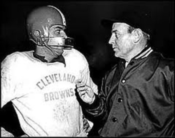 Browns head coach Paul Brown (right) invented the helmet face mask to help protect his QB Otto Graham (left).