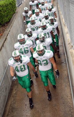 HOUSTON - NOVEMBER 17: The Marshall Thundering Herd hold a rope as they walk down the ramp to take the field for the game with the Houston Cougars at Robertson Stadium November 17, 2007 in Houston, Texas. Houston won 35-28. (Photo by Stephen Dunn/Getty Im