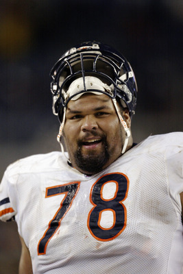 DENVER - NOVEMBER 23:  Tackle Aaron Gibson #78 of the Chicago Bears smiles en route to victory over the Denver Broncos on November 23, 2003 at Invesco Field at Mile High in Denver, Colorado. The Bears defeated the Broncos 19-10.  (Photo by Brian Bahr/Gett