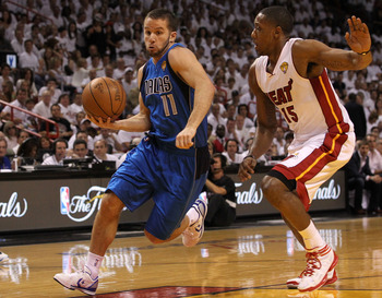 MIAMI, FL - JUNE 12:  Jose Juan Barea #11 of the Dallas Mavericks drives against Mario Chalmers #15 of the Miami Heat in Game Six of the 2011 NBA Finals at American Airlines Arena on June 12, 2011 in Miami, Florida. NOTE TO USER: User expressly acknowledg