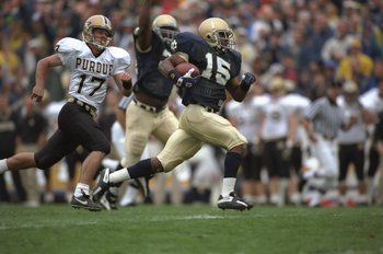 14 Sep 1996: Kick returner Allen Rossum #15 of the Notre Dame Fighting Irish bursts up field as he runs with the football during a 99 yard kick off return for a touch down in the Irish's 35-0 victory over the Boilermakers at Notre Dame Stadium in South Be