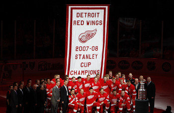 DETROIT - OCTOBER 09:  Members of the 2007-2008 Detroit Red Wings pose for a photo in front of their Stanley Cup championship banner prior to playing the Toronto Maple Leafs on October 9, 2008 at Joe Louis Arena in Detroit, Michigan.  (Photo by Gregory Sh