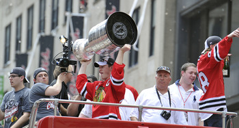 CHICAGO - JUNE 11: Jonathan Toews of the Chicago Blackhawks (L) holds up the Stanley Cup as his teammate, Patrick Kane (R), waves to fans during the Chicago Blackhawks victory parade on June 11, 2010 in Chicago, Illinois. (Photo by Jim Prisching/Getty Ima