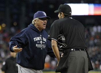 DETROIT - JUNE 13:  Tampa Bay Rays manager Joe Maddon #70 argues with home plate umpire John Tumpane #74 after a close play at the plate in the seventh inning during the game at Comerica Park on June 13, 2011 in Detroit, Michigan. The Tigers defeated the