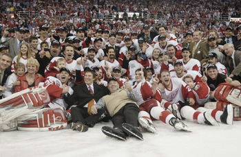 DETROIT, MI - JUNE 13:  The Detroit Red Wings take a team photo while celebrating winning the Stanley Cup after eliminating the Carolina Hurricanes during game five of the NHL Stanley Cup Finals on June 13, 2002 at the Joe Louis Arena in Detroit, Michigan