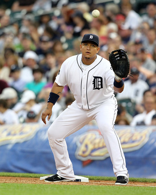 DETROIT, MI - JUNE 09:  Miguel Cabrera #24 of the Detroit Tigers catches the ball at first base in a MLB game against the Seattle Mariners at Comerica Park on June 9, 2011 in Detroit, Michigan.  The Tigers defeated the Mariners 4-1  (Photo by Dave Reginek
