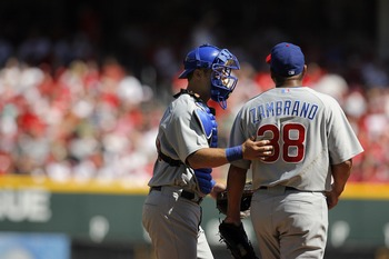 CINCINNATI - APRIL 2:   Catcher Michael Barrett #8 of the Chicago Cubs talks to pitcher Carlos Zambrano #38 during Opening Day action against the Cincinnati Reds April 2, 2007 at Great American Ballpark in Cincinnati, Ohio.  Cincinnati led 5-1 after five
