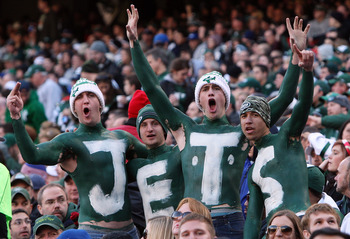 EAST RUTHERFORD, NJ - NOVEMBER 29:  Fans of the New York Jets cheer on their team against the Carolina Panthers on November 29, 2009 at Giants Stadium in East Rutherford, New Jersey. The Jets defeated the Panthers 17-6.  (Photo by Jim McIsaac/Getty Images