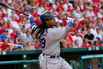 ST. LOUIS - JULY 15:  Manny Ramierez #99 of the Los Angeles Dodgers bats against the St. Louis Cardinals at Busch Stadium on July 15, 2010 in St. Louis, Missouri.  (Photo by Dilip Vishwanat/Getty Images)