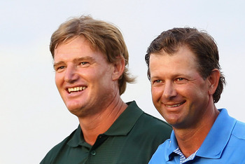 DURBAN, SOUTH AFRICA - DECEMBER 19:  Ernie Els of South Africa is congratulated by Retief Goosen of South Africa after the final round during the South African Open Golf Championship at the Durban Country Club on December 19, 2010 in Durban, South Africa.