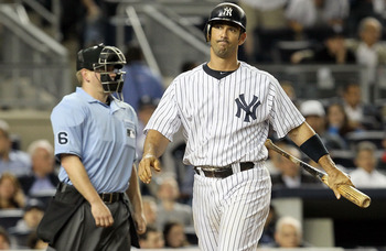 NEW YORK, NY - JUNE 13:  Jorge Posada #20 of the New York Yankees strikes out in the ninth inning against the Cleveland Indians on June 13, 2011 at Yankee Stadium in the Bronx borough of New York City. Cleveland defeated the Yankees 1-0.  (Photo by Jim Mc