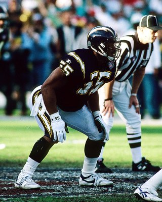 SAN DIEGO, CA - JANUARY 8:  Linebacker Junior Seau of the San Diego Chargers looks into the opposing backfield against the Miami Dolphins in the 1994 AFC Divisional Playoff Game at Jack Murphy Stadium on January 8, 1994 in San Diego, California. The Charg