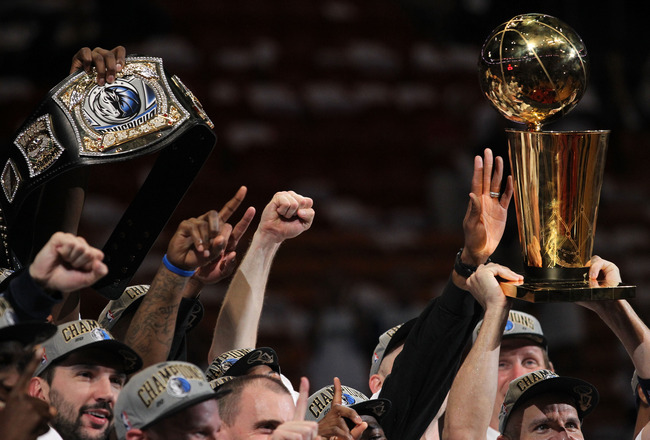 MIAMI, FL - JUNE 12: The Dallas Mavericks celebrate with a belt and the Larry O'Brien trophy after the Mavericks won 105-95 against the Miami Heat in Game Six of the 2011 NBA Finals at American Airlines Arena on June 12, 2011 in Miami, Florida. NOTE TO US