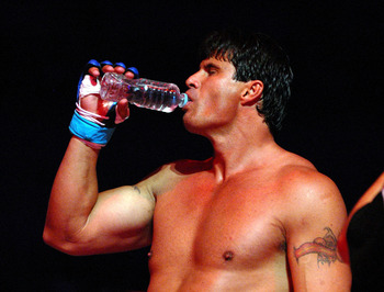 YOKOHAMA, JAPAN - MAY 26:  Former Oakland Athletics slugger Jose Canseco drinks a bottle of water prior to the match with Choi Hong-man at first Round of Super Hulk Tournament during Dream.9 at Yokohama Arena on May 26, 2009 in Yokohama, Kanagawa, Japan.