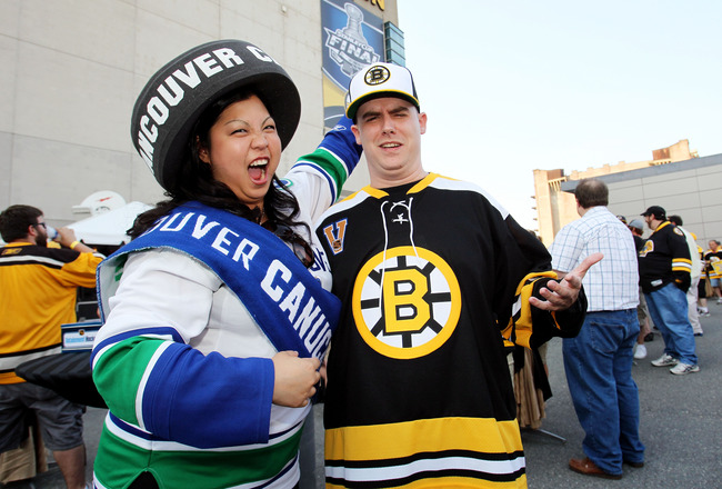 BOSTON, MA - JUNE 08:  A fan of the Vancouver Canucks  and a fan of the Boston Bruins pose for a photo prior to Game Four of the 2011 NHL Stanley Cup Final between the Vancouver Canucks and the Boston Bruins at TD Garden on June 8, 2011 in Boston, Massach