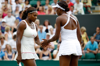 LONDON, ENGLAND - JUNE 26:  Serena Williams of USA and Venus Williams of USA in action during their doubles match against Dominika Cibulkova of Slovakia and Anastasia Pavlyuchenkova of Russia  on Day Six of the Wimbledon Lawn Tennis Championships at the A
