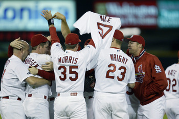 ST. LOUIS - OCTOBER 5:  The St. Louis Cardinals pay tribute to teammate Darryl Kile #57 who past away early in the year, as they celebrate the victory over the Arizona Diamondbacks in Game three of the MLB National League Division Series during the 2002 W