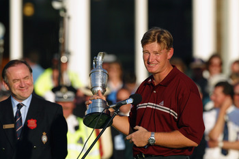 GULLANE - JULY 21:  Ernie Els of South Africa makes his victory speech as Peter Dawson looks on after the 131st Open Championship held at Muirfield Golf Club in Gullane, Scotland on July 21, 2002. (Photo by David Cannon/Getty Images)