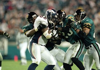 13 Dec 1999:  Byron Chamberlain #86 of the Denver Broncos carries the ball as he is tackled by  Jacksonville Jaguars at the Altell Stadium in Jacksonville, Florida. The Jaguars defeated the Broncos 27-24. Mandatory Credit: Andy Lyons  /Allsport