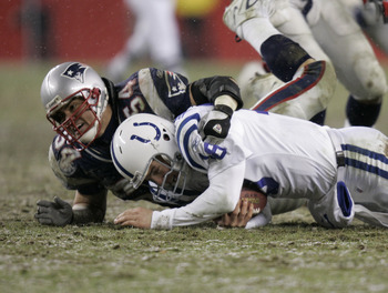 Linebacker Tedy Bruschi of the New England Patriots sacks Colts quarterback Peyton Manning during the AFC Division playoff game at Gillette Stadium in Foxboro, Massachusetts on January 16, 2005. The Patriots beat the Colts 20-3 to advance to the AFC Champ