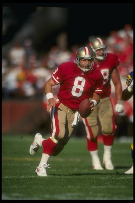 4 Oct 1992:  Quarterback Steve Young of the San Francisco 49ers runs with the ball during a game against the Los Angeles Rams at Candlestick Park in San Francisco, California.  The 49ers won the game, 40-17. Mandatory Credit: Otto Greule  /Allsport