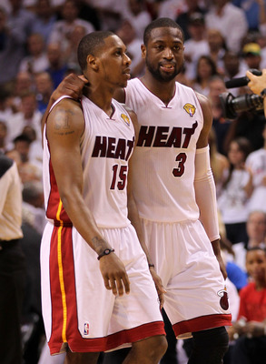 MIAMI, FL - JUNE 12:  (L-R) Mario Chalmers #15 and Dwyane Wade #3 of the Miami Heat talk on court against the Dallas Mavericks in the first half of Game Six of the 2011 NBA Finals at American Airlines Arena on June 12, 2011 in Miami, Florida. NOTE TO USER