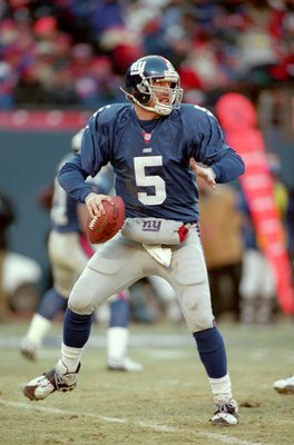 23 Dec 2000:  Quarterback Kerry Collins #5 of the New York Giants moves back to pass the ball during the game against the  Jacksonville Jaguars at the Giants Stadium in East Rutherford, New Jersey.  The Giants defeated the Jaguars 28-26.Mandatory Credit: